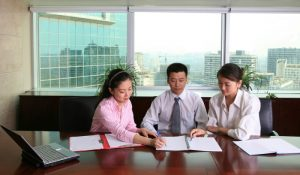 young Asian business people at the office