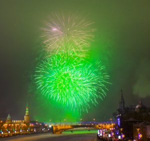 Moscow, Kremlin - December 31, 2012: salute near Kremlin and bridge on Moscow-river in New year night. Salutes take place on different public holidays.