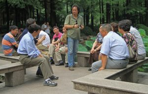 Shanghai, China - July 1, 2015: chinese people are communicating in park of Shanghai, China