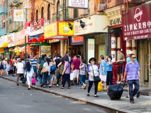NEW YORK,USA - AUGUST 15,2015 : Tourists and chinese immigrants at Chinatown in New York City
