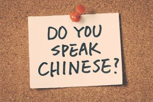 Do you speak Chinese note pinned on the bulletin board