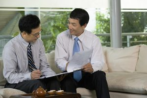 Two Chinese businessmen in a meeting